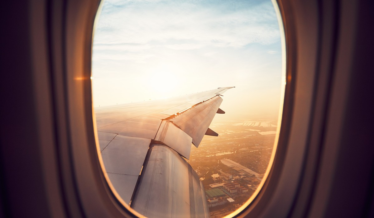 View from the window of the airplane at the sunrise. Landing in Bangkok, Thailand.