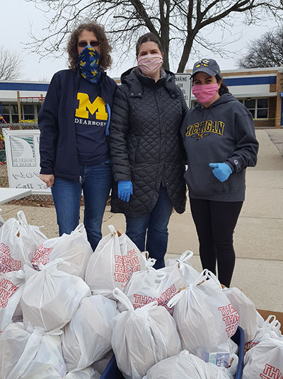Veronica Kubitz, Julia Zamarron, and Jennie Morey (pictured from left to right) volunteered to provide students at the elementary school where they worked with access to breakfast and lunch.
