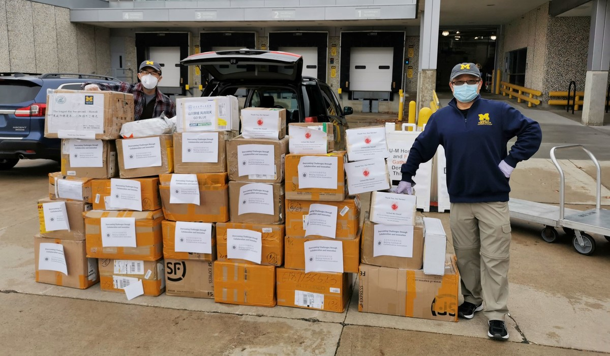 Bin Zhao (left) and Chuanwu Xi are two members of the U-M Association of Chinese Professors, which collected donations of personal protective equipment for Michigan Medicine and other area health care facilities.