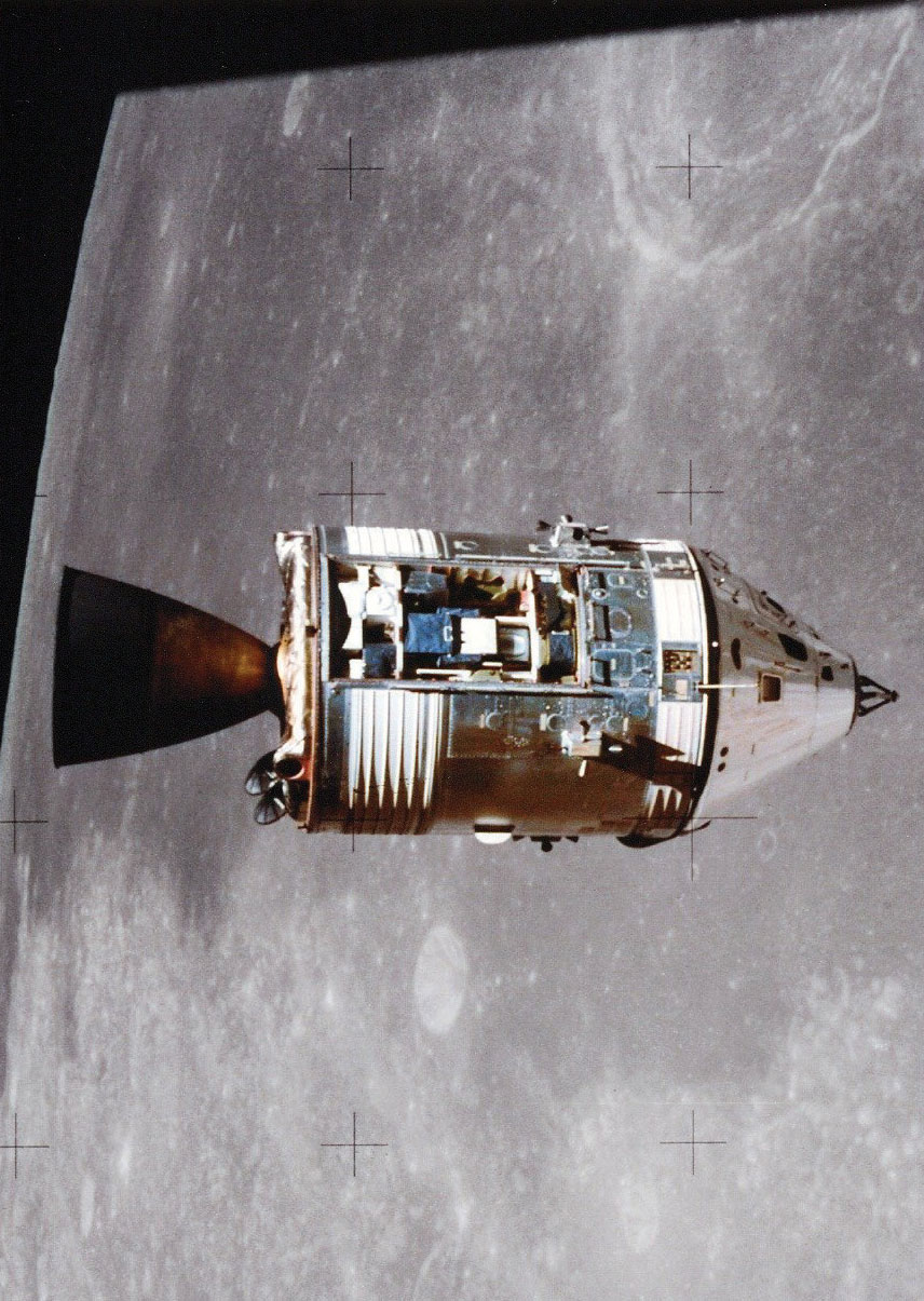 """As photographed from the lunar module, the Apollo 15 command and service modules are in lunar orbit with the moon's surface in the background. Worden piloted the command module while Scott and Irwin were on the moon's surface. The three days he spent alone earned him a place in the """"Guinness Book of World Records"""" as the """"most isolated human being."""""""