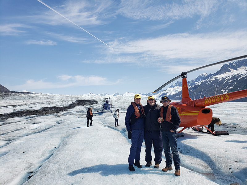 Three friends celebrated their 50th anniversary of rooming together at U-M during a trip to Alaska's Hubbard Glacier. From left to right are Steven Rosenthal, '71; David Bloom, '71; and Ron Schnaar, '72.