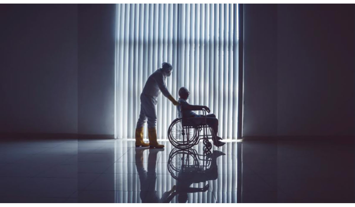COVID Patient Being Pushed In Wheelchair Gatewayextension