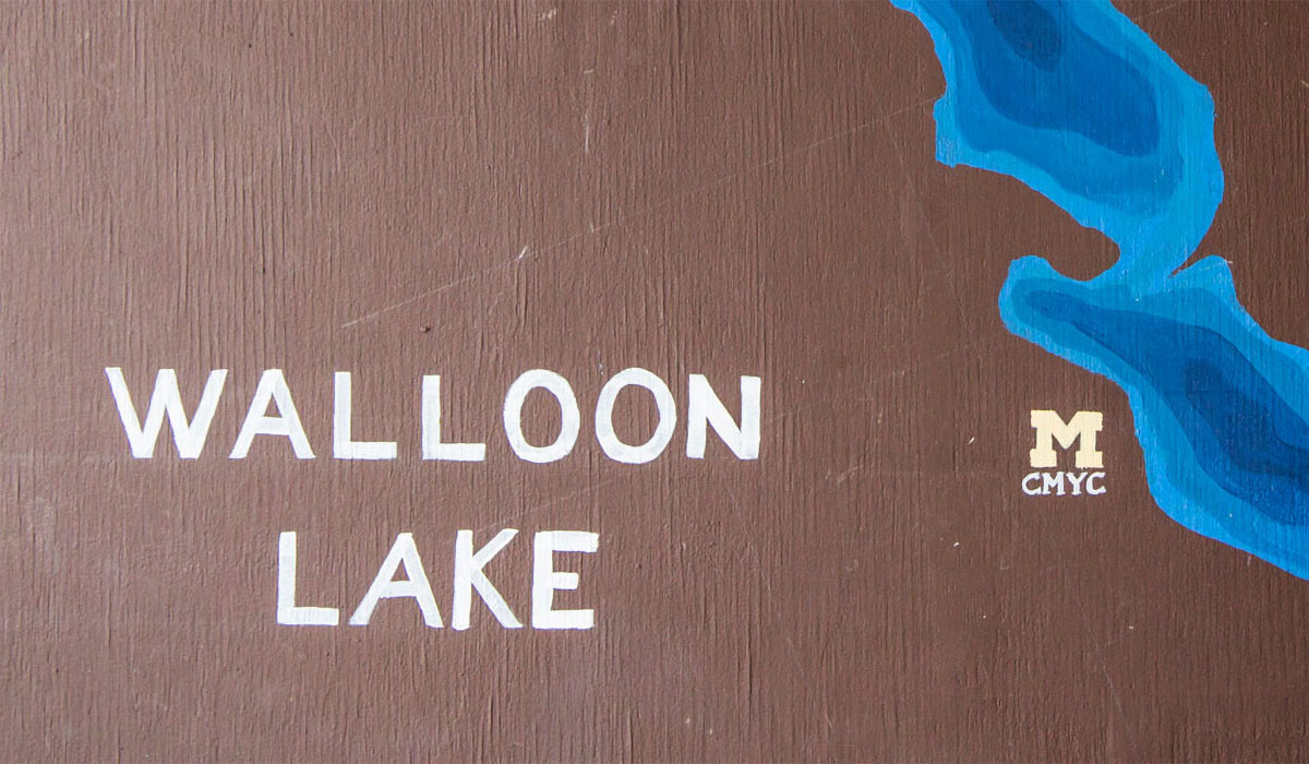 """""""Walloon Lake"""" spelled out on painting next to block M"""