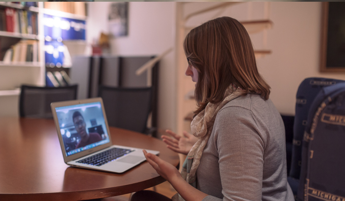 Woman video-chatting with someone on a computer