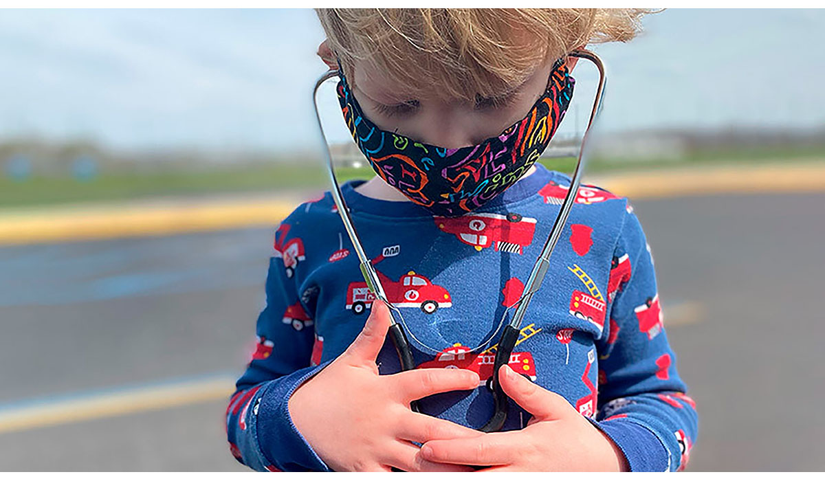 Child With Stethoscope And Mask