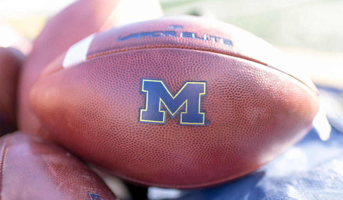 Football with a navy block M for the University of Michigan