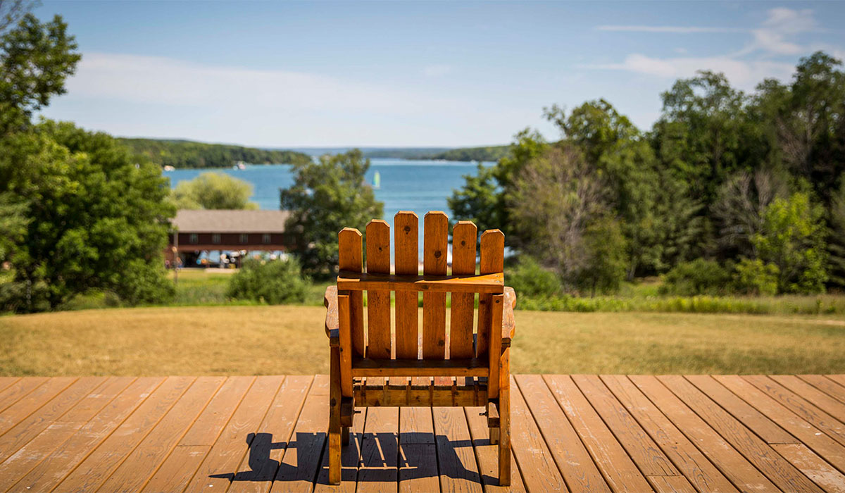 Adirondack chair facing Walloon Lake at Camp Michigania