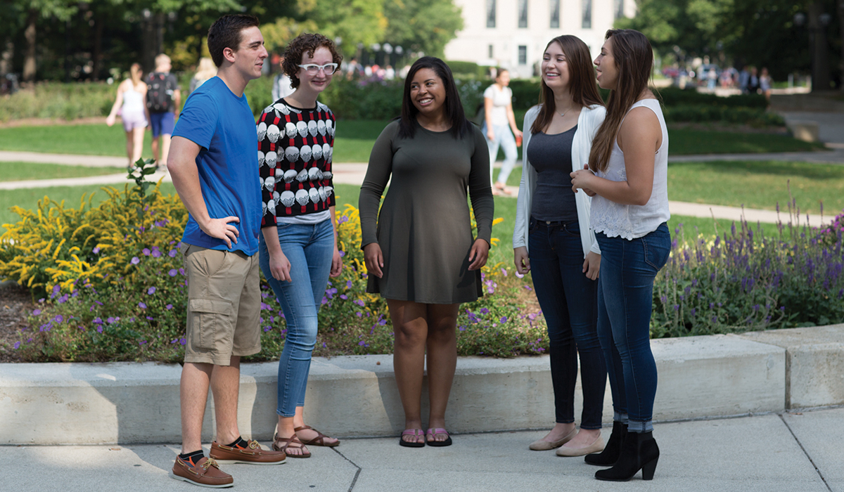 Students talking on Central Campus at the University of Michigan in Ann Arbor