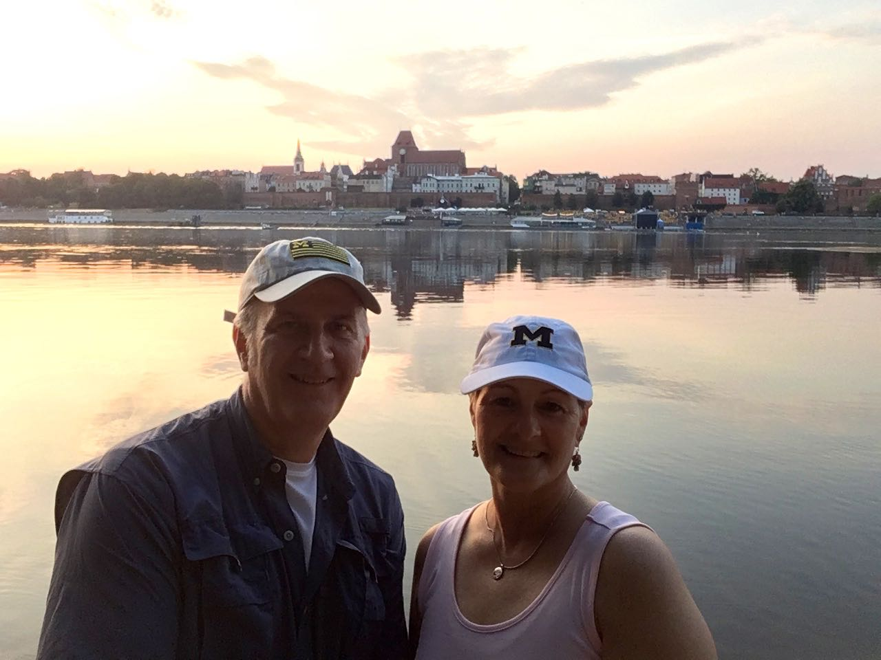 John Hembruch, '84, and Therese Barnes Hembruch, '83, created their own family heritage tour of old Prussia over the summer. Here, they stood on the south bank of the Vistula River, with the medieval town of Toruń, Poland, in the background.