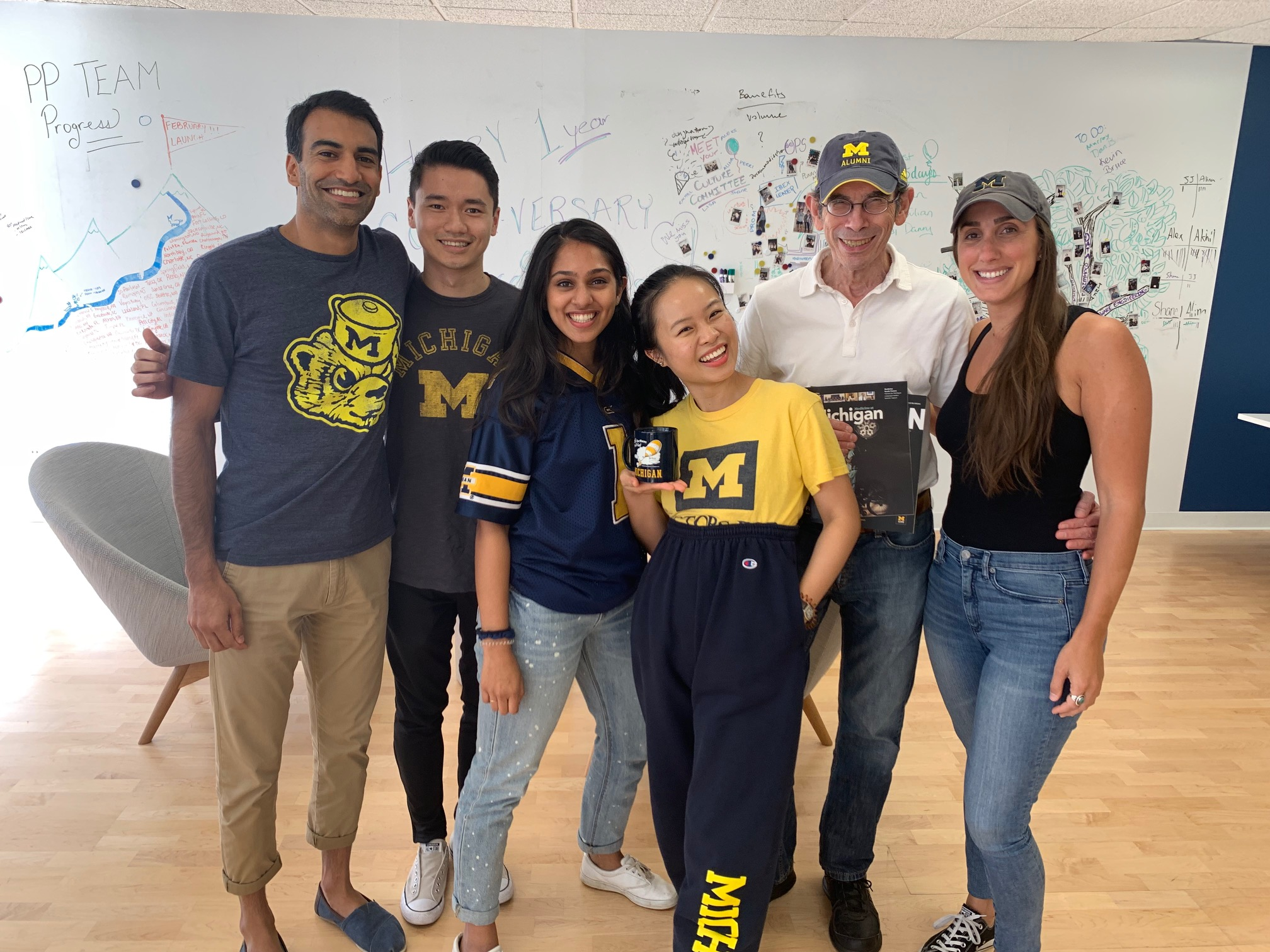 Colleagues at Covera Health, a New York City start-up health care firm, celebrated the beginning of football season with a group photo. From left to right are: Akhil Shah, '09, MHSA'12; Andrew Li, '15; Sahithi Akasapu, '17; Rachel Liang, '17; Richard Herzog, '67, MD'71; and Alyssa Glasser, a University of Massachusetts alumna who got into the spirit of the proceedings.