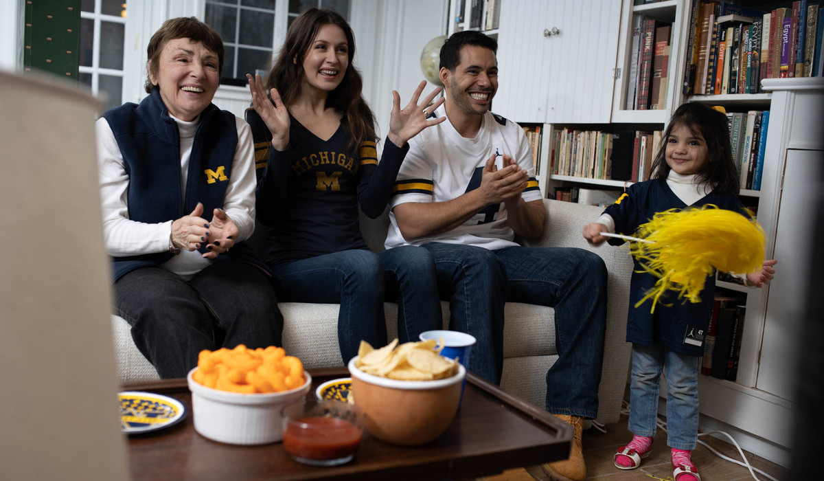 A family watches a Michigan game at home