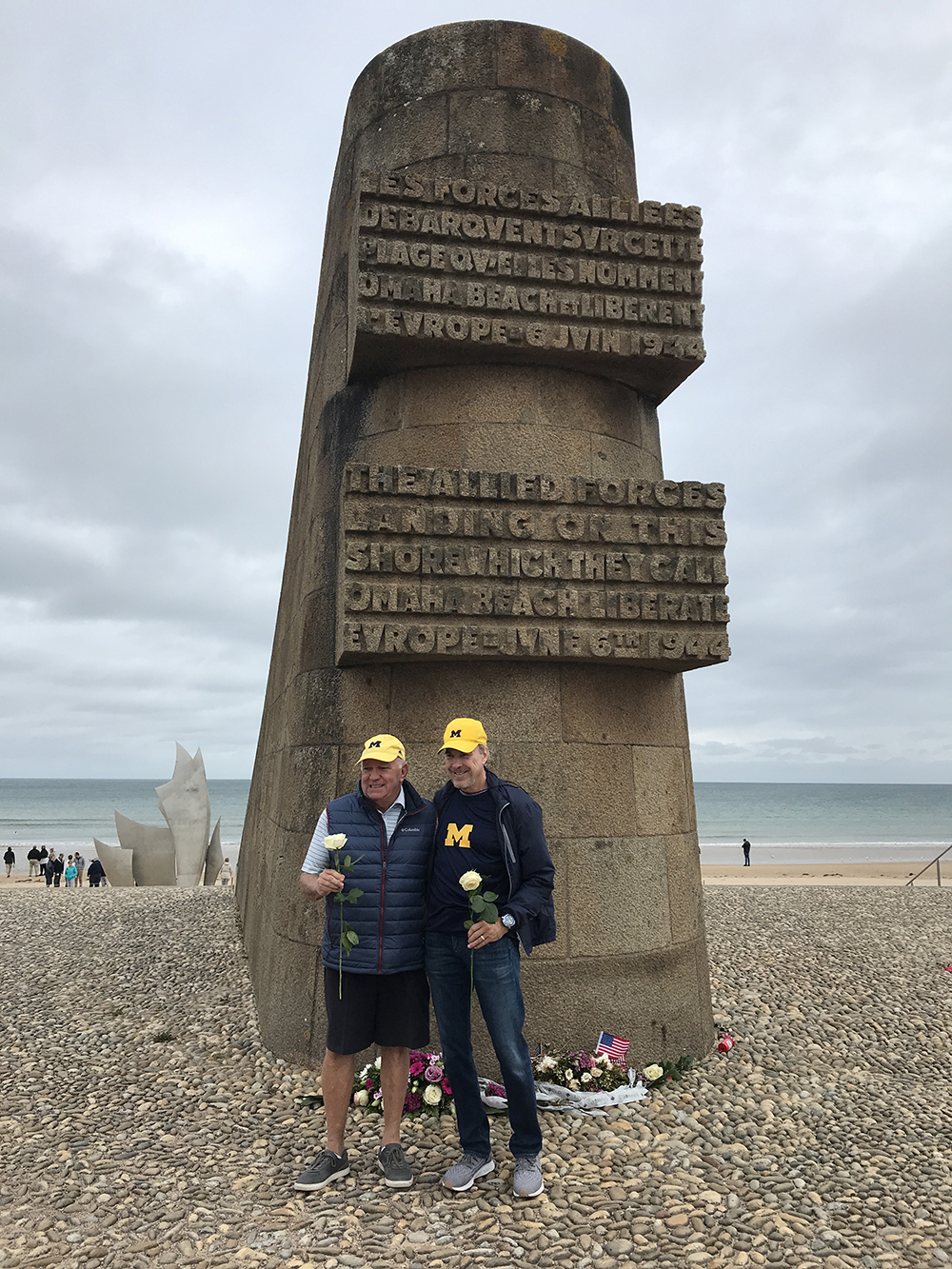 Dennis J. Jacobs, PhD'83, and Gregory Smith, '66, paid respects to the Allied soldiers of D-Day at the Omaha Beach Memorial in in Saint-Laurent-sur-Mer, Normandy, France.