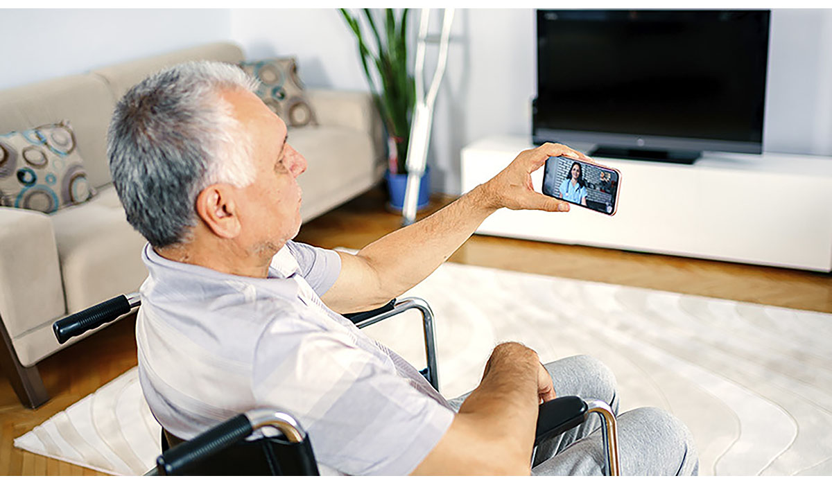 Man In Wheelchair Telehealth Doctor Smartphone