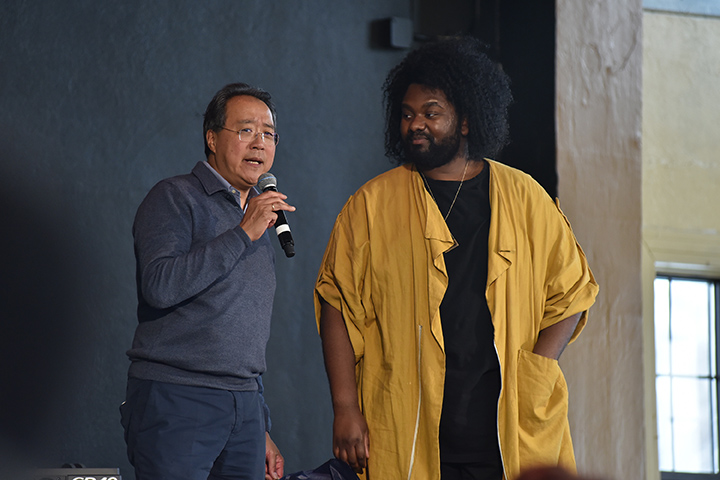 Throughout the day, Yo-Yo Ma was accompanied by one of Flint's hometown heroes: songwriter and recording artist Tunde Olaniran, '04, MPA'05, who is a beloved fixture in the Detroit music scene.Throughout the day, Yo-Yo Ma was accompanied by one of Flint's hometown heroes: songwriter and recording artist <strong>Tunde Olaniran, '04, MPA'05</strong>, who is a beloved fixture in the local music scene.