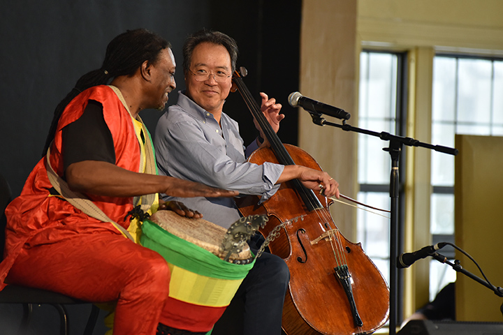 After performing the very first Bach piece he learned as a child, Yo-Yo Ma asked Baba Collins from the Kuungana African Drum and Dance Company in Flint to join him for a second piece.
