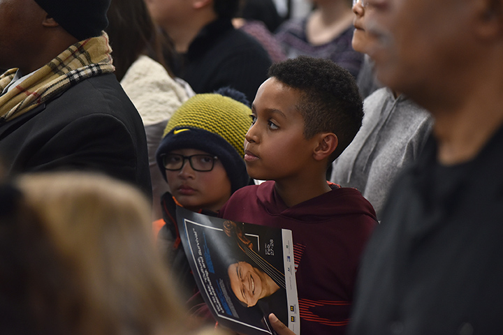 A child at Berston Field House in Flint waits for the start of the community cultural showcase and to hear Yo-Yo Ma perform. The showcase featured a wide spectrum of performances and presentations by local artists.