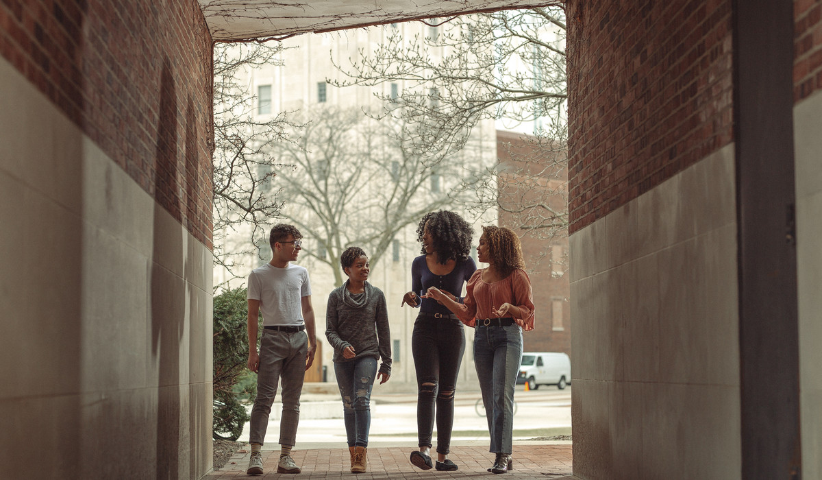LEAD Scholars talking outside the Alumni Center at the University of Michigan