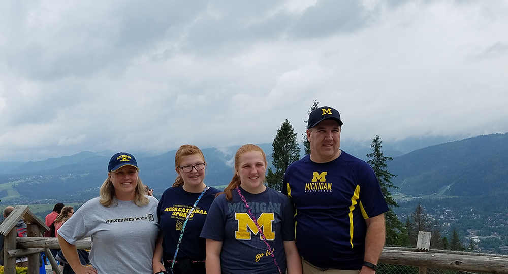 Laura Phy-Daly, '92, (left) and her family wore their Maize and Blue to the mountain Gubałówka, above the town of Zakopane, Poland.