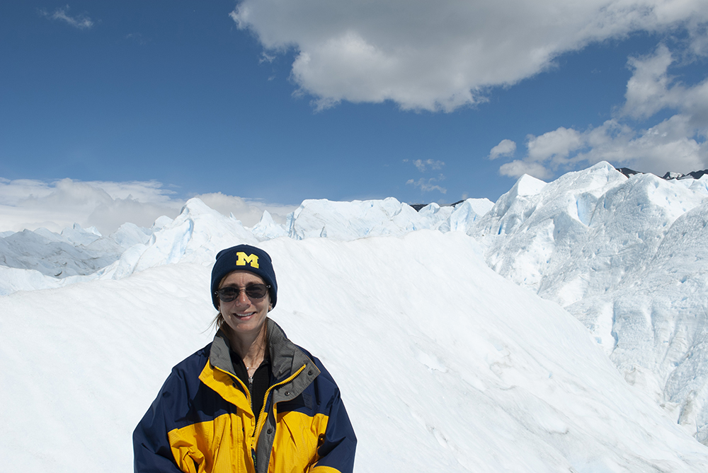 Sarah Sherber, '83, stays warm in Maize and Blue as she takes in the icy vistas of Los Glaciares National Park in Argentina.