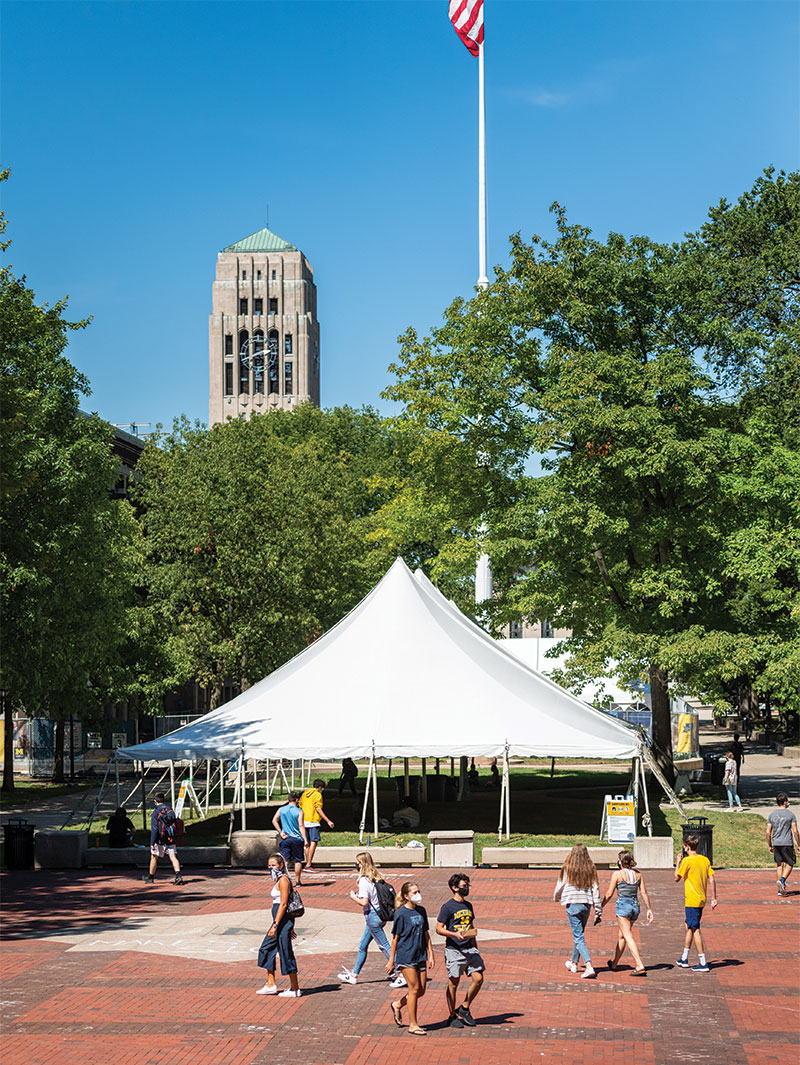 In an effort to give students additional space where they can study and take a break between classes, U-M has erected 13 canopies around campus. Nine of the canopies are located Central Campus (including this one on the Diag) and four on North Campus. Combined, they provide seating for approximately 500 people. Even though the canopies are located outside, students must wear a mask and social distance. (Photo by Scott C. Soderberg/Michigan Photography)