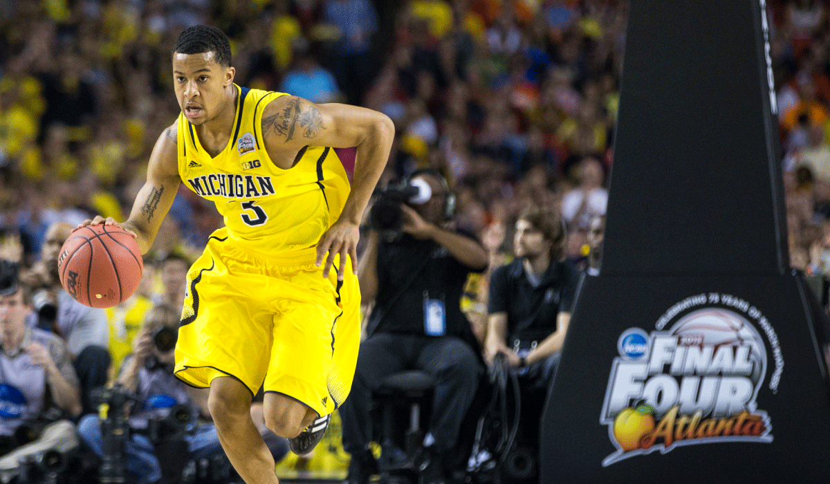 Michigan basketball's Trey Burke dribbles at the Final Four
