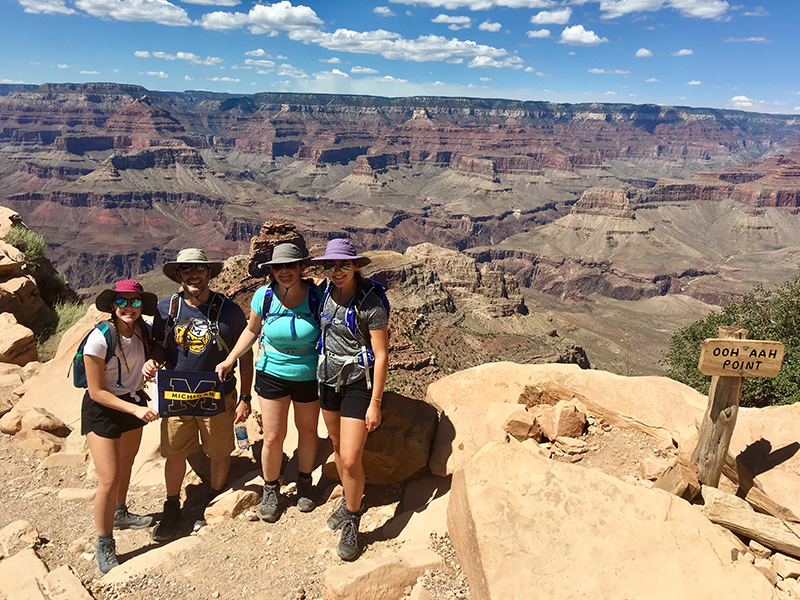 The Whitman clan hails from the South Kaibab Trail of Grand Canyon National Park in August. From left to right: Sarah Whitman, '23; Dave Whitman, '90; Annette Whitman, '89; and current U-M student Hannah Whitman.