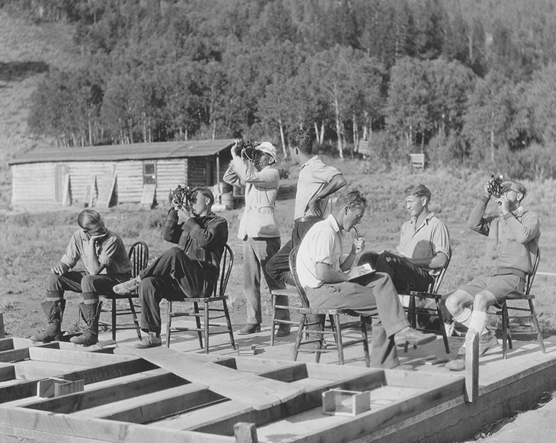 Campers conduct survey activities in 1929.