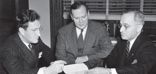 Truman and Fulton (center) meet with another man in the senator's office.