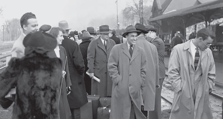 Members of the committee and others, including U-M students, prepare to board a train at the station in Ann Arbor after inspecting the Ford Motor Company Willow Run Bomber Plant in Ypsilanti.