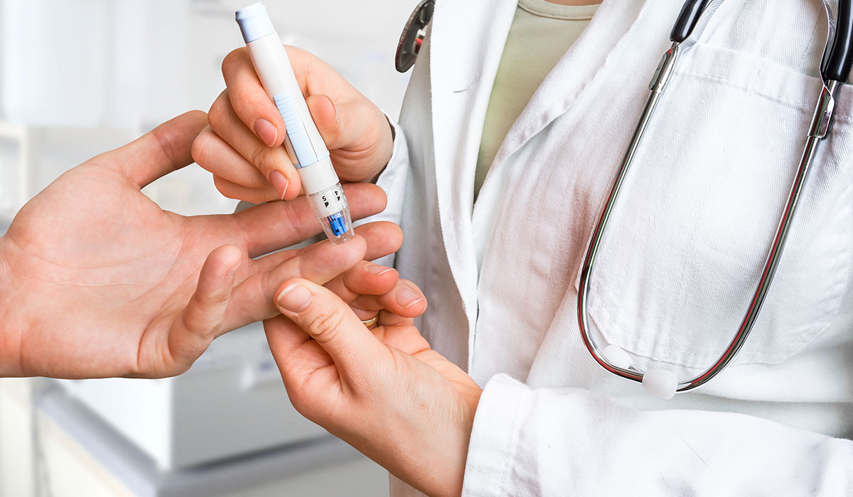 Measuring Blood Sugar On Finger Diabetes Concept